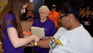 volunteers with patient