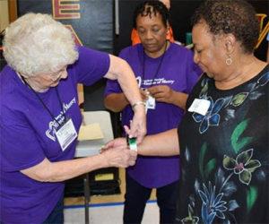 volunteers helping patient